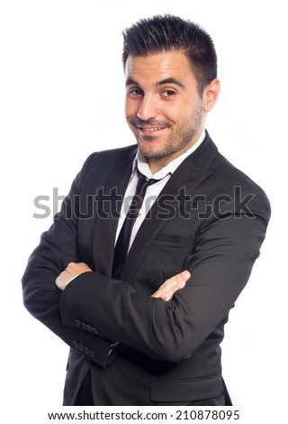 Portrait of a young businessman with arms crossed isolated on white background