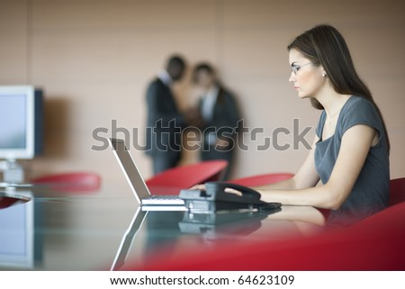 Portrait of a young businesswoman, colleagues on backgrounds