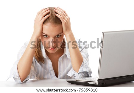 Portrait of a young businesswoman in front of a laptop