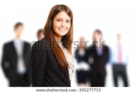Portrait of a young businesswoman in front of her team - stock photo