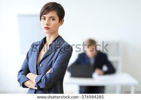 Portrait of a young businesswoman leader in the office - stock photo