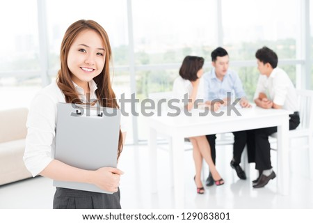 Portrait of a young businesswoman on the foreground - stock photo