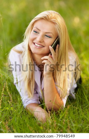 Portrait of a young businesswoman outdoor speaking on mobile phone