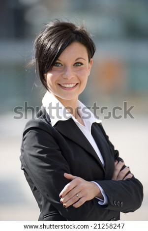 Portrait of a young businesswoman outdoorsomaking a phone call - stock photo