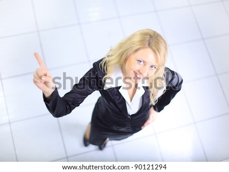 Portrait of a young businesswoman pointing her finger up