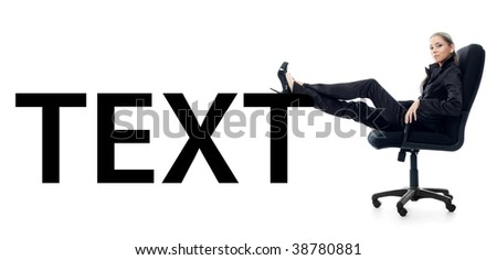 Portrait of a young businesswoman sitting in a chair with feet up on text. - stock photo