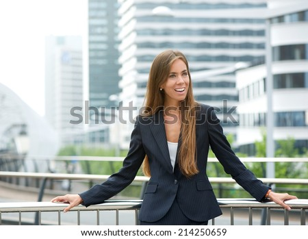 Portrait of a young businesswoman standing outdoors in the city