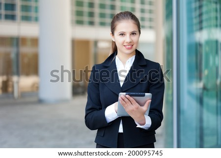 Portrait of a young businesswoman using a digital tablet