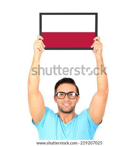 Portrait of a young casual man holding up board with National flag of Poland - stock photo