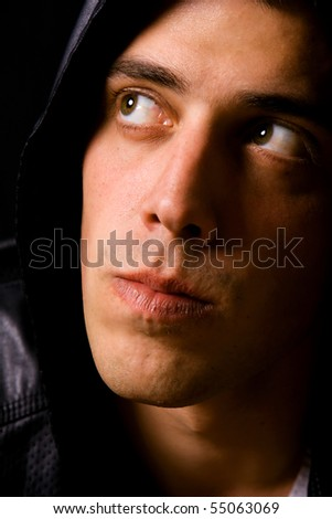 Portrait of a young casual man on black background