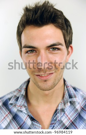 portrait of a young casual man on white background - stock photo