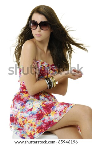 portrait of a young casual woman relaxing in a wood chair. - stock photo