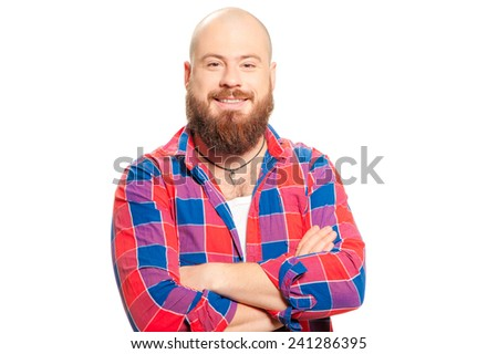 Portrait of a young caucasian bald man with long beard in casual shirt. Standing, smiling and holding his arms crossed. - stock photo