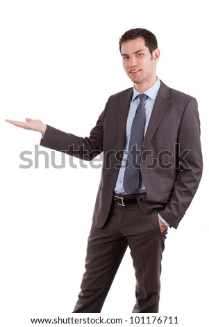 Portrait of a young caucasian business man man holding something,isolated on white background