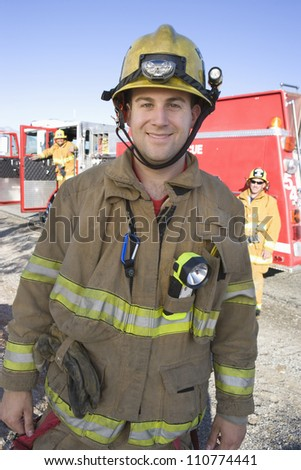 Portrait of a young caucasian firefighter - stock photo