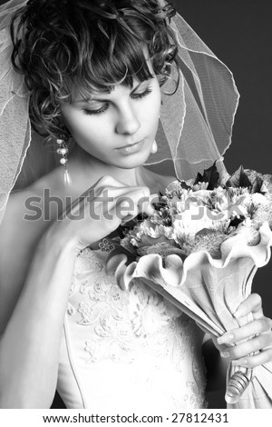 portrait of a young charming bride with her wedding bouquet