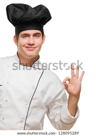 Portrait Of A Young Chef Gesturing On White Background - stock photo