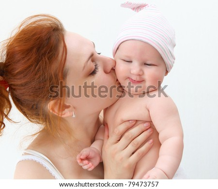 Portrait of a young child and his mother a white background. Baby. - stock photo