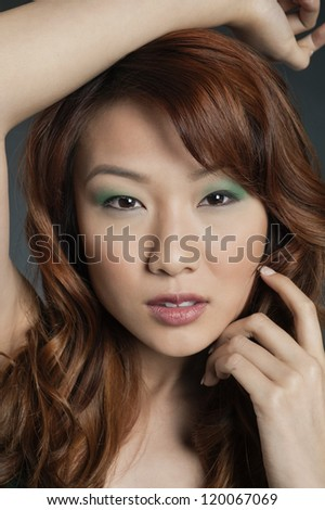 Portrait of a young Chinese woman with eye shadow