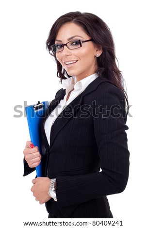 Portrait of a young confident business woman holding a clipboard - stock photo