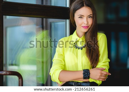Portrait of a young confident business woman smiling.  - stock photo