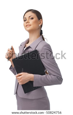 Portrait of a young confident businesswoman holding a clipboard and a pen - stock photo