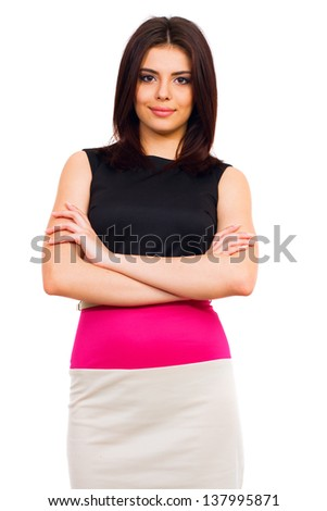 Portrait of a young confident woman in dress - stock photo