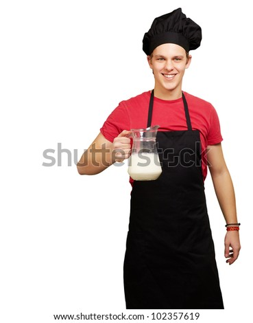 portrait of a young cook man holding a milk jar over a white background - stock photo