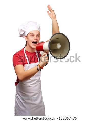portrait of a young cook man shouting with a megaphone over a white background - stock photo
