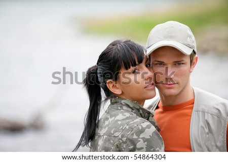 Portrait of a young couple at a lakeside