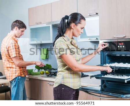 Portrait of a young couple at kitchen
