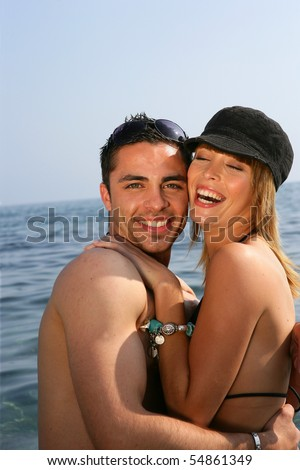 Portrait of a young couple bathing in the sea - stock photo