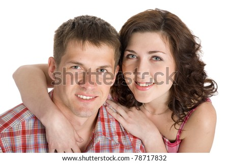 Portrait of a young couple in love. Isolated on white. - stock photo