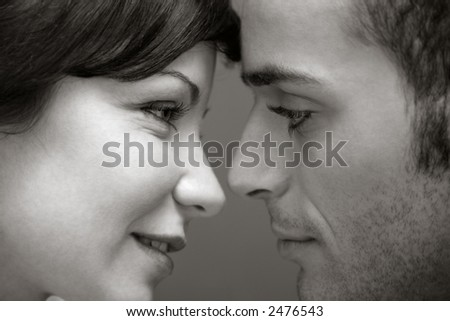 portrait of a young couple kissing each other - stock photo