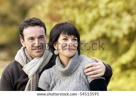 Portrait of a young couple smiling in the countryside - stock photo