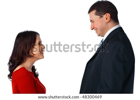 Portrait of a young couple standing opposite and looking at each other