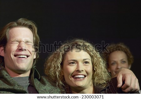 Portrait of a young couple watching a funny movie - stock photo