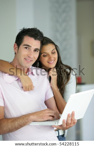 Portrait of a young couple with a laptop computer