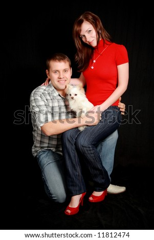Portrait of a young couple with their dog. - stock photo