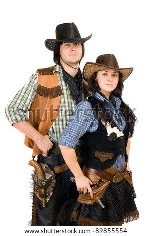 Portrait of a young cowboy and cowgirl - stock photo