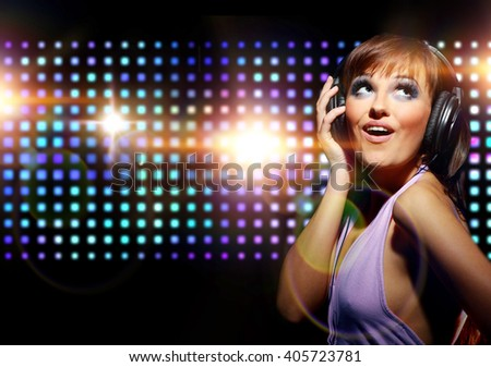 Portrait of a young dancing girl in headphones  - stock photo