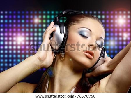 Portrait of a young dancing girl in headphones - stock photo