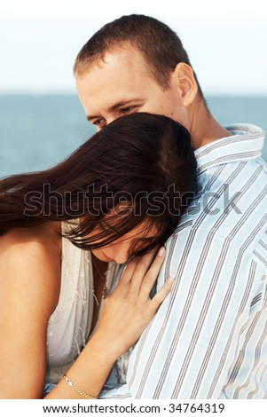 Portrait of a young dreamy couple. - stock photo