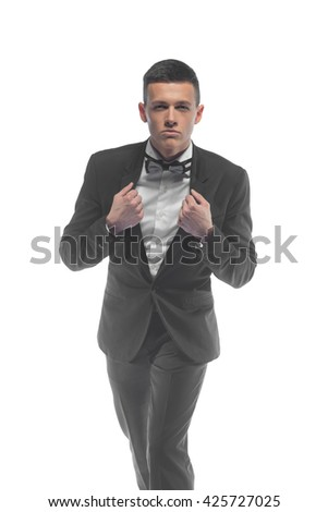 Portrait of a young elegant handsome business man isolated on white background - stock photo