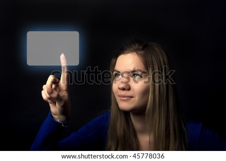 Portrait of a young emotional woman touching digital button - stock photo