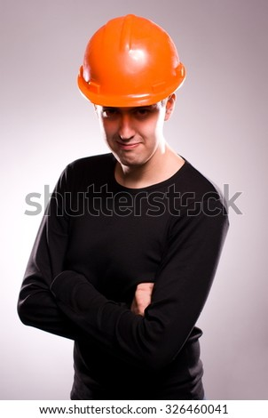 Portrait of a young engineer wearing protective helmet