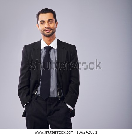 Portrait of a young executive in business suit - stock photo