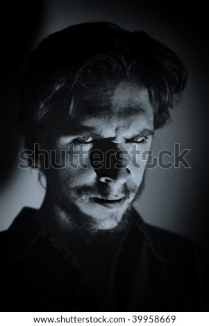 Portrait of a young expressive man - stock photo