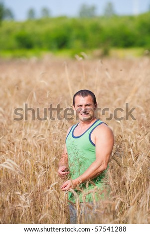 Portrait of a young farmer in his wheat field