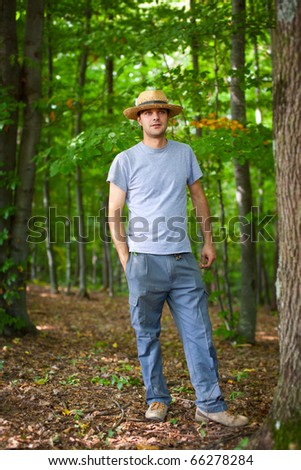 Portrait of a young farmer in the forest